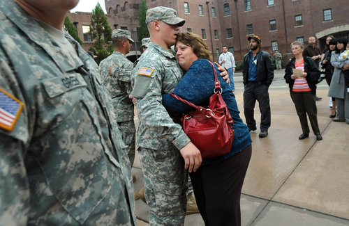 Mom hugs soldier